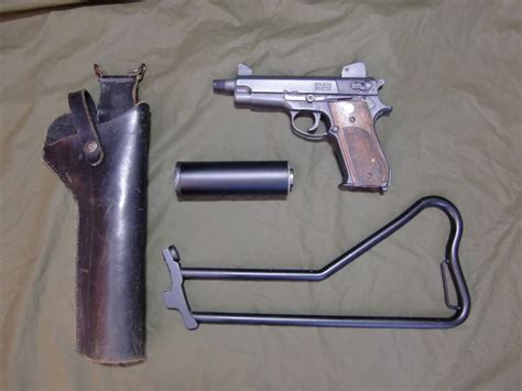 hush puppy pistol us smith wesson 22 hush puppy later sold as model 59 15 9mm seal
