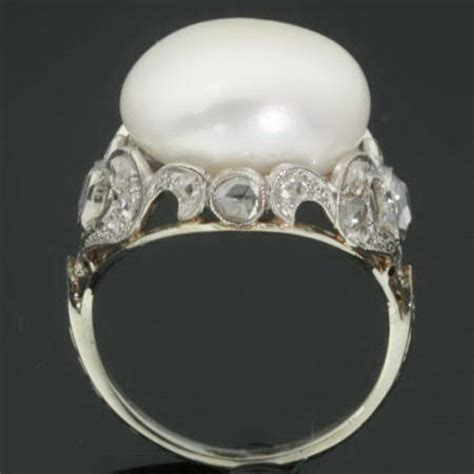 white gold estate engagement ring with impressive pearl