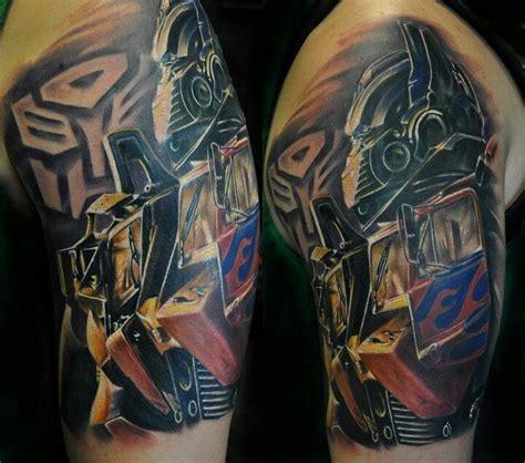 transformer tattoo pin by virginia stewart on tattoos