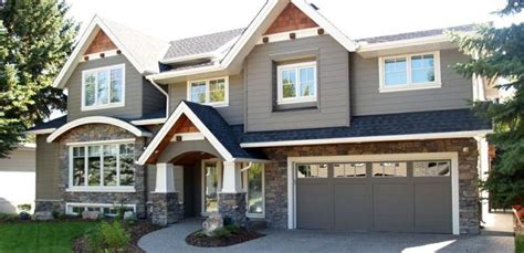houses painted gray dark gray house with faux rock and brown accents white trim