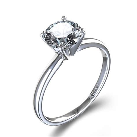 timeless four prong solitaire engagement ring in