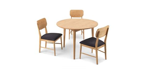 circular oak dining table skioa circular dining table with 2 chairs lifestyle