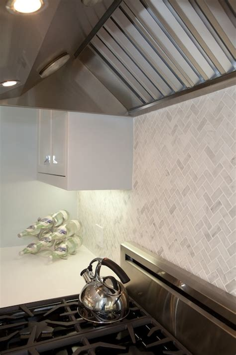 marble herringbone backsplash cottage kitchen marsh and clark