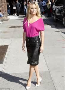 kate hudson slips into tight leather skirt and killer