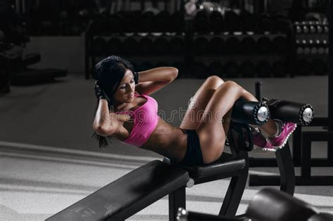 bench body women fitness woman in sport wear with perfect body in gym stock