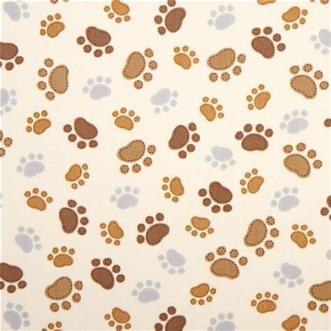 dog pattern wallpaper cream timeless treasures fabric with funny paw prints