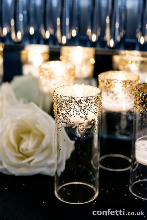 Host An Art Deco Chagne Bar Wedding Reception Black And Gold Wedding Centerpieces