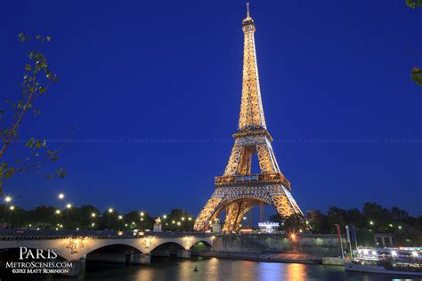 paris pictures eiffel tower flashing with the river seine at night