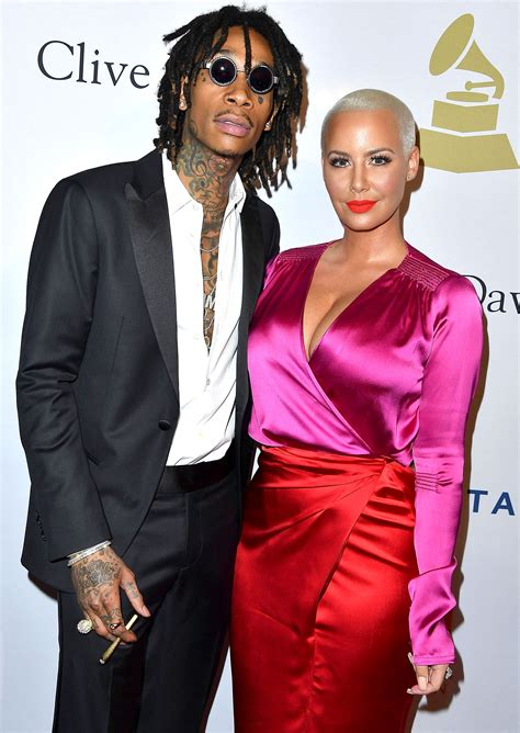 amber rose amp wiz khalifa kiss at pre grammys party