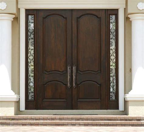 double entrance doors double wood door  wrought iron