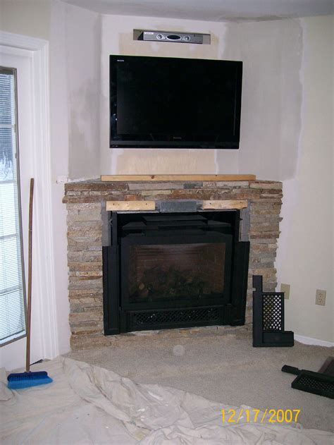 pictures above fireplace decorate your home with a corner fireplace mantel