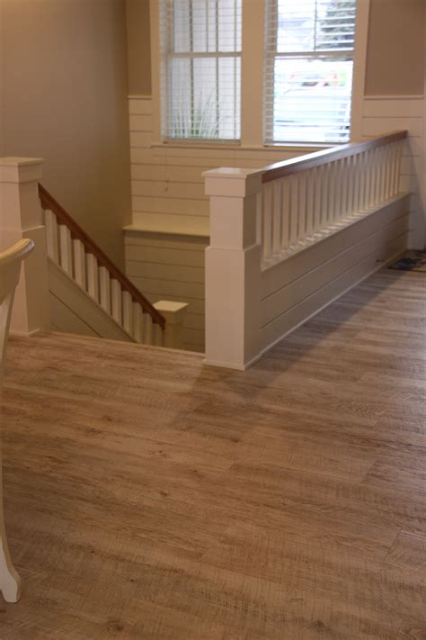 luxury vinyl plank wood flooring hallway stairs