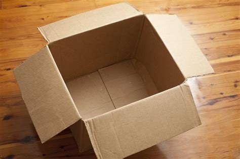 Empty Cardboard Box with Open Flaps on Wood Floor   Free