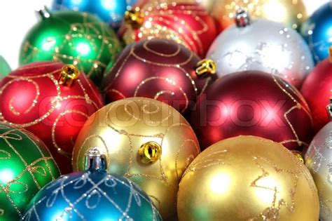 multi coloured christmas ornaments close up stock photo