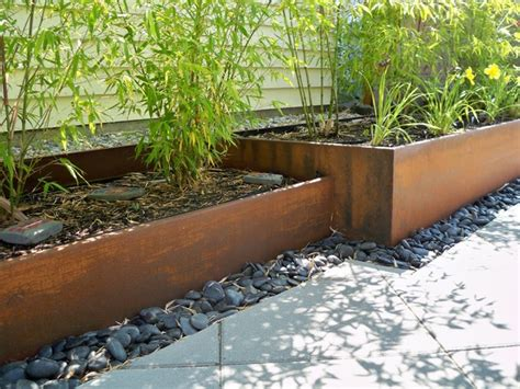 rusted steel planters and bamboo contemporary landscape seattle by greener living