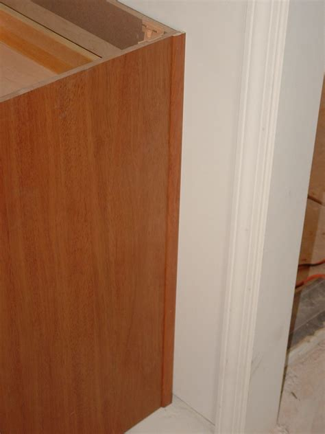 how to fix cabinet door panel install kitchen cabinet scribe molding cabinets matttroy