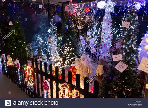 display of illuminated christmas decorations for sale in a