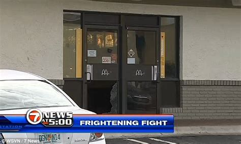 mcdonalds glass door miami charged with shooting mcdonald s worker who