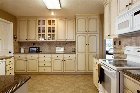 kitchen with cream cabinets cabinets telisa s furniture and cabinet refinishing