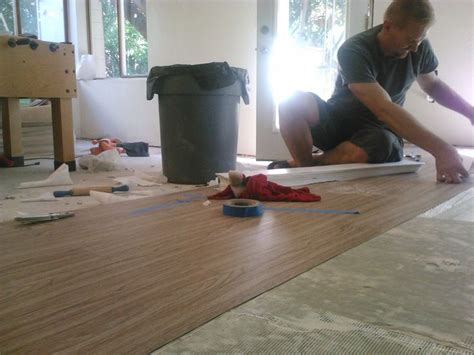 vinyl floor in basement laying vinyl plank flooring fixing up our unfinished
