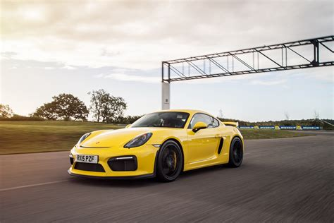 yellow porsche side view porsche cayman gt4 4k uhd wallpaper hd wallpapers