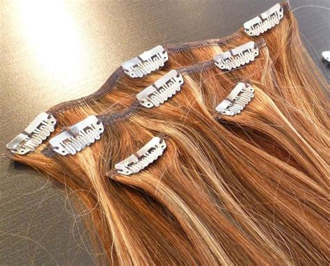 how to put hair clip extensions in how to clip in hair extensions in 9 simple steps