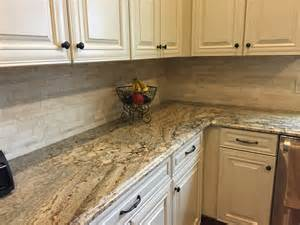 brown kitchan cabinet and kitchen island with quartz vs