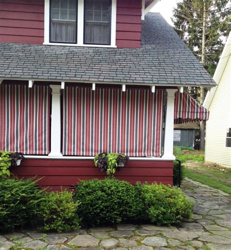 roll up awnings porch red stripe sunbrella roll curtains residential porch