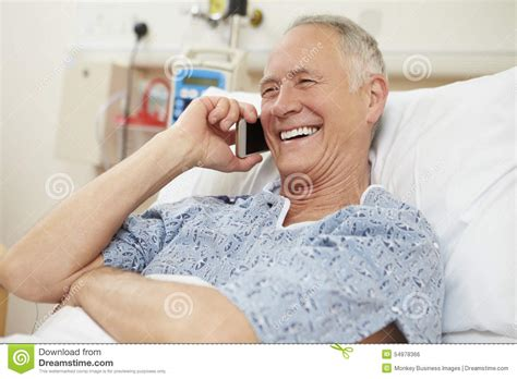 man using cell phone in bed stock images image 33817024 senior male patient using mobile phone in hospital bed