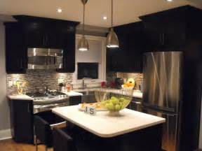 ivory kitchens with black appliances kitchen color ideas oak cabinets and
