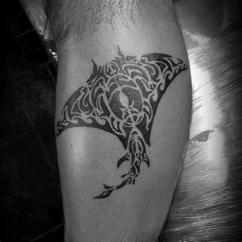 how much would a small just black ink tattoo cost picture small black ink ray tattoo on leg stylized with tribal