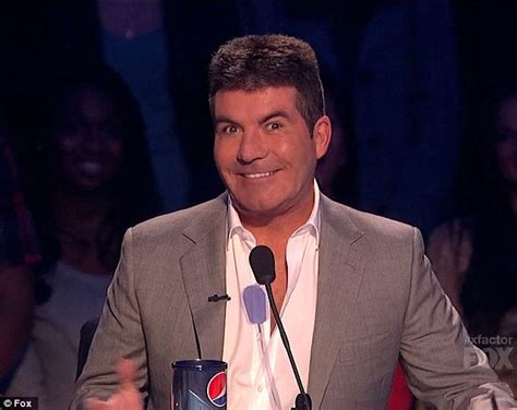 simon cowell fat face simon cowell displays fuller face and double chin during x
