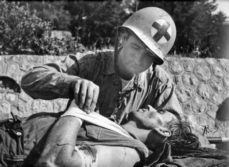 T Backer Wwii 1944 quot quot baker treating a captured german soldier possibly in southern