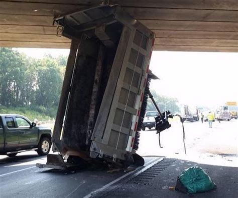 garbage truck bed route 222 opens after penndot dump truck gets wedged under