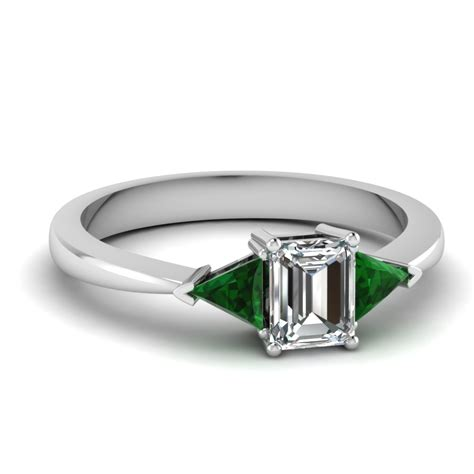 affordable three green emerald engagement rings