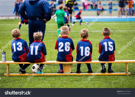 how many players on the bench in soccer football soccer match children kids waiting stock photo