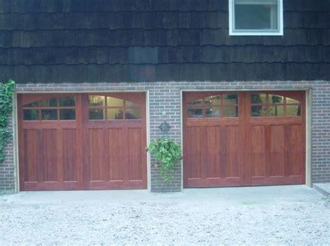 Clopaydoor Residential Garage Doors by Clopay Reserve Collection Wood Carriage House Garage Doors