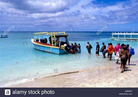 glass bottom boat vanuatu tourist boarding a glass bottom boat pigeon point tobago