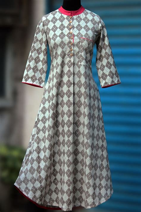 button pattern kurti a high collared long kurta with an applecut with rouge