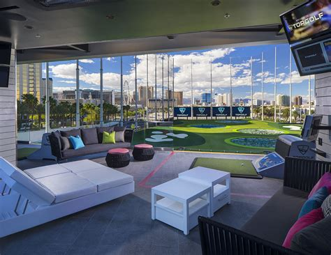 driving range with lights near me is topgolf las vegas the city s hautest range