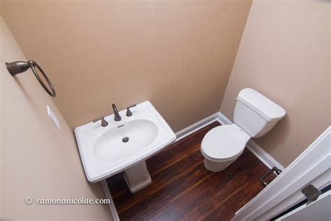 can laminate flooring go in a bathroom installing laminate under bathroom toilet and sink