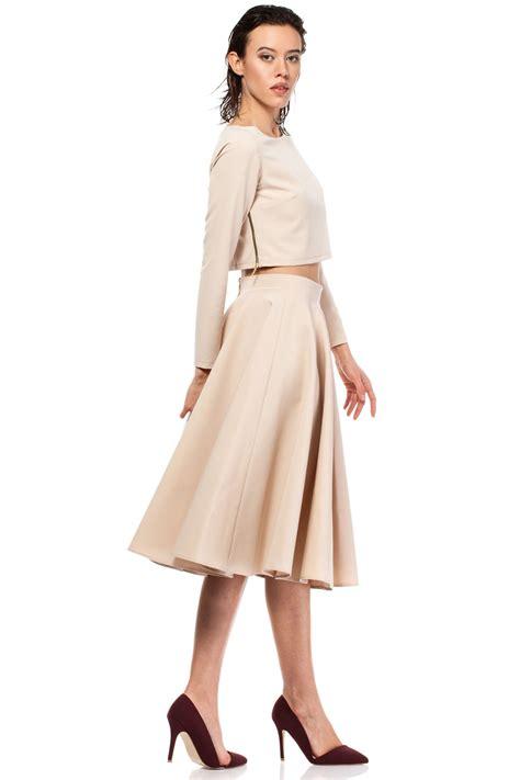 beige pleated midi skirt with back zipper fastening