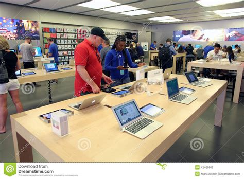 deck top computers for sale apple computer retail store editorial photography image