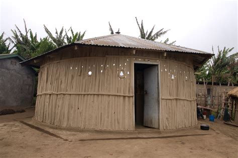 outside of a house file maasai house outside jpg