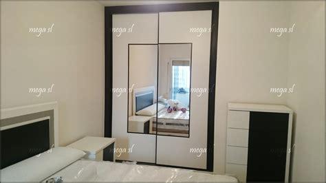 armario melamina blanco armario corredera en melamina blanco negro combinada con