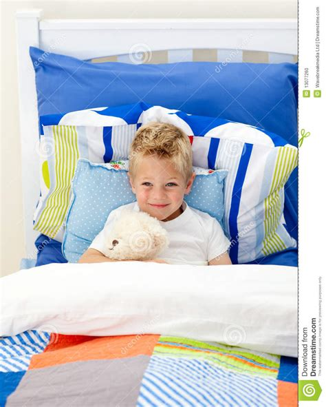 and boys in bed adorable boy lying in bed stock photo image 13077260