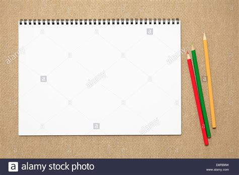 sketchbook with colored paper colored pencils and sketchbook stock photo royalty free