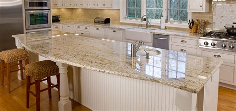 beige kitchen cabinets with typhoon bordeaux granite white kitchen cabinets granite countertop and tan walls
