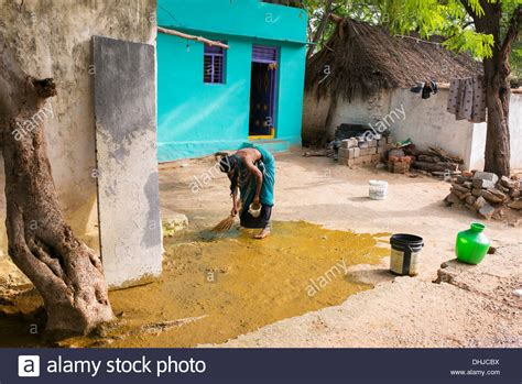 cow poop house india travellerspoint travel photography indian custom of a woman spreading watered down cow dung
