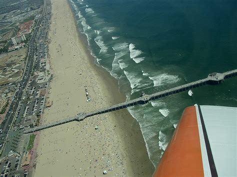 What S The Catch With Pch - pch huntington beach pier from the air saltair catch a wave and you re sitting on